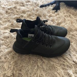 Dark Green Nike running shoes